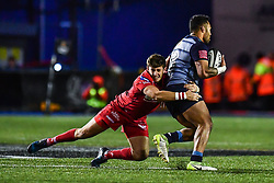 Cardiff Blues' Willis Halaholo is tackled by Scarlets' Dan Jones - Mandatory by-line: Craig Thomas/Replay images - 31/12/2017 - RUGBY - Cardiff Arms Park - Cardiff , Wales - Blues v Scarlets - Guinness Pro 14