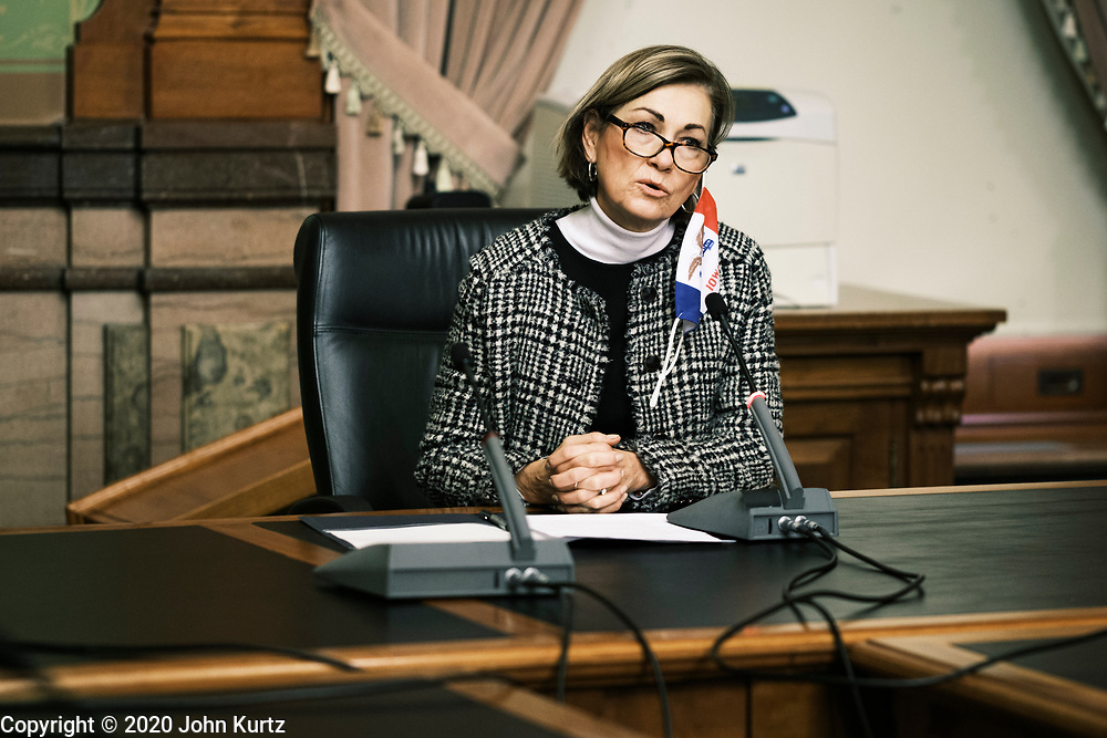 14 DECEMBER 2020 - DES MOINES, IOWA: KIM REYNOLDS, the Governor of Iowa, talks to Iowa's Electors during the Electoral College vote. Iowa's six Electors met at the State Capitol Monday and voted for President Donald Trump and Vice President Mike Pence, cementing Trump's victory in Iowa. Trump carried Iowa by 8.2 percent in the November 3 general election.     PHOTO BY JACK KURTZ