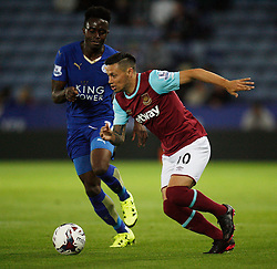 Joe Dodoo of Leicester City (L) and Mauro Zarate of West Ham United in action  - Mandatory byline: Jack Phillips/JMP - 07966386802 - 22/09/2015 - SPORT - FOOTBALL - Leicester - King Power Stadium - Leicester City v West Ham United - Capital One Cup Round 3