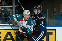 KELOWNA, CANADA - JANUARY 25: Liam Kindree #26 of the Kelowna Rockets is checked by Jameson Murray #6 of the Victoria Royals during second period  on January 25, 2019 at Prospera Place in Kelowna, British Columbia, Canada.  (Photo by Marissa Baecker/Shoot the Breeze)