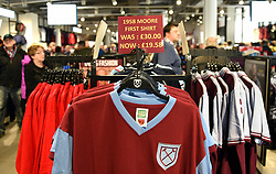 T-shirts for sale to commemorate the 25th anniversary of the passing of Bobby Moore during the Premier League match at the London Stadium.