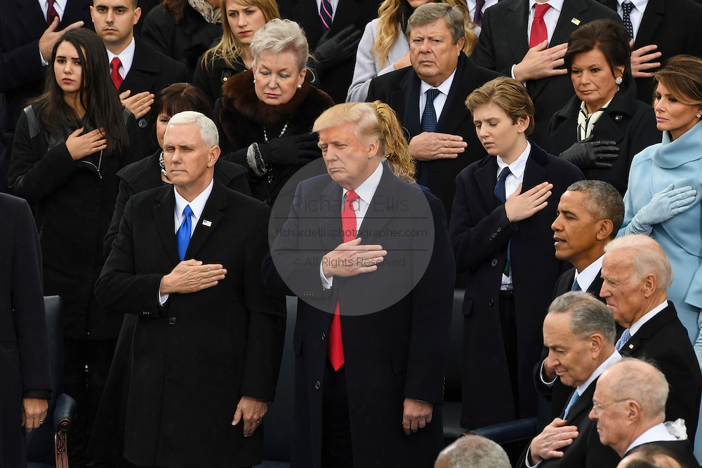 President Donald Trump and Vice President Mike Pence stand for the pledge following the oath of office to become the 45th President of the United States of America on Capitol Hill January 20, 2017 in Washington, DC.