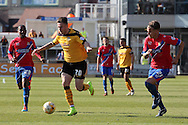 Newport's Miles Storey breaks through flanked by Dagenham's Andre Bougard (28) and Matt Partridge (21). Skybet football league two match , Newport county v Dagenham & Redbridge at Rodney Parade in Newport, South Wales on Saturday 18th April 2015.<br /> pic by David Richards, Andrew Orchard sports photography.