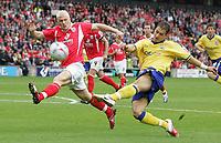 Photo: Paul Thomas.<br /> Barnsley v Southampton. Coca Cola Championship. 19/08/2006.<br /> <br /> Bobby Hassell (L) of Barnsley tries to stop Rudi Skacel's shot at goal.