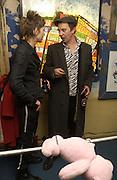 Bridget Hugo and Joe Rush, Opening of  Santa's Ghetto. Mixed art exhibition.  9 Berwick St. Soho, London. 30  November 2005. ONE TIME USE ONLY - DO NOT ARCHIVE  © Copyright Photograph by Dafydd Jones 66 Stockwell Park Rd. London SW9 0DA Tel 020 7733 0108 www.dafjones.com