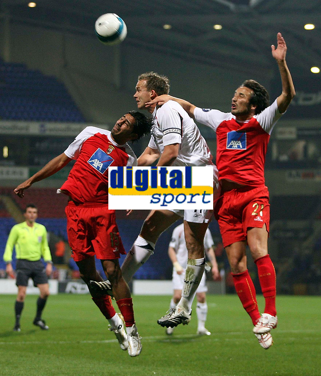 Photo: Paul Thomas.<br /> Bolton Wanderers v Braga. UEFA Cup. 25/10/2007.<br /> <br /> Captain Kevin Davies (White) of Bolton battles with Wender (15) and Cesar Peixoto (21). *** Local Caption *** *** UK ONLY ***