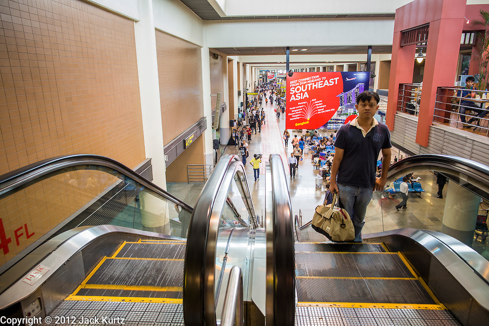01 OCTOBER 2012 - BANGKOK, THAILAND:  The departure hall at Don Mueang International Airport during grand reopening ceremonies Monday. Don Mueang International Airport is the smaller of two international airports serving Bangkok, Thailand. Suvarnabhumi Airport, opened in 2006 is the main one. Don Mueang was officially opened as a Royal Thai Air Force base on 27 March 1914 and commercial flights began in 1924. Don Mueang Airport closed in 2006 following the opening of Bangkok's new Suvarnabhumi Airport, and reopened as a domestic terminal for low cost airlines after renovation on 24 March 2007. Closed during the flooding in 2011, Don Mueang was again renovated and reopened in 2012 as the airport for low cost airlines serving both domestic and international passengers. On Monday, Air Asia, Asia's leading low cost airline, transferred all of their flight operations to Don Mueang and the airport was officially reopened. Suvarnabhumi International Airport is already over capacity and Don Mueang's importance as a hub is expected to grow.   PHOTO BY JACK KURTZ