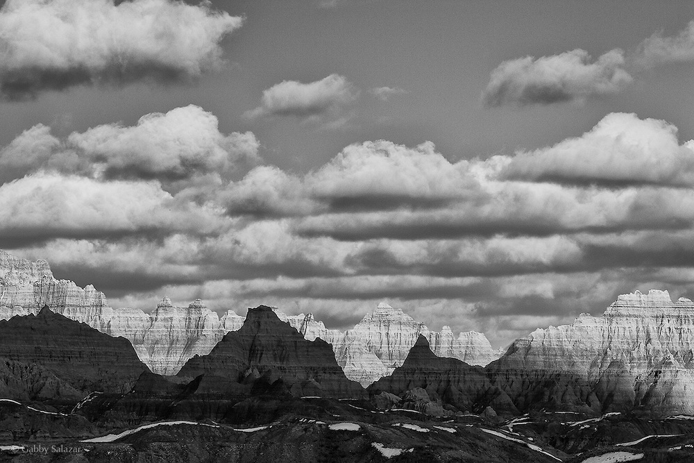 Clouds over buttes, Badlands National Park, South Dakota, USA.
