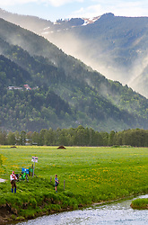 THEMENBILD - Fliegenfischer beim angeln, dahinter eine vom Wind aufgewirbelte Pollenwolke über der Schmitten, aufgenommen am 29. April 2018 in Zell am See, Österreich // Fly fisherman while fishing, behind a cloud of pollen swirled by the wind hangs over the the Schmitten in Zell am See, Austria on 2018/04/29. EXPA Pictures © 2018, PhotoCredit: EXPA/ JFK