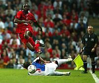 Fotball. Premier League. 28.02.2002.<br /> Blackburn v Liverpool.<br /> Djimi Traore, Liverpool.<br /> Tugay, Blackburn<br /> Foto: David Rawcliffe, Digitalsport