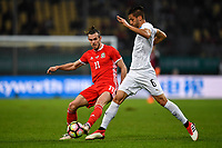 """Gareth Bale, left, of Wales national football team kicks the ball to make a pass against Rodrigo Bentancur of Uruguay national football team in their final match during the 2018 Gree China Cup International Football Championship in Nanning city, south China's Guangxi Zhuang Autonomous Region, 26 March 2018.<br /> <br /> Edinson Cavani's goal in the second half helped Uruguay beat Wales to claim the title of the second edition of China Cup International Football Championship here on Monday (26 March 2018). """"It was a tough match. I'm very satisfied with the result and I think that we can even get better if we didn't suffer from jet lag or injuries. I think the result was very satisfactory,"""" said Uruguay coach Oscar Tabarez. Wales were buoyed by a 6-0 victory over China while Uruguay were fresh from a 2-0 win over the Czech Republic. Uruguay almost took a dream start just 3 minutes into the game as Luis Suarez's shot on Nahitan Nandez cross smacked the upright. Uruguay were dealt a blow on 8 minutes when Jose Gimenez was injured in a challenge and was replaced by Sebastian Coates. Inter Milan's midfielder Matias Vecino of Uruguay also fired at the edge of box from a looped pass but only saw his attempt whistle past the post. Suarez squandered a golden opportunity on 32 minutes when Ashley Williams's wayward backpass sent him clear, but the Barca hitman rattled the woodwork again with goalkeeper Wayne Hennessey well beaten."""