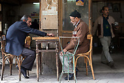 Men play backgammon outside a cafe on Hamid Farid Street in Downtown Cairo, Egypt