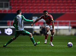 Adrian Mariappa of Bristol City is challenged by Jed Wallace of Millwall - Mandatory by-line: Ryan Hiscott/JMP - 15/12/2020 - FOOTBALL - Ashton Gate - Bristol, England - Bristol City v Millwall - Sky Bet Championship