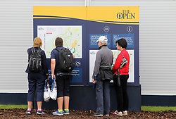 Spectators look at an information board during day three of The Open Championship 2017 at Royal Birkdale Golf Club, Southport. PRESS ASSOCIATION Photo. Picture date: Saturday July 22, 2017. See PA story GOLF Open. Photo credit should read: Richard Sellers/PA Wire. RESTRICTIONS: Editorial use only. No commercial use. Still image use only. The Open Championship logo and clear link to The Open website (TheOpen.com) to be included on website publishing. Call +44 (0)1158 447447 for further information.