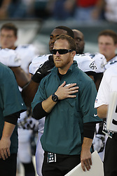 Philadelphia Eagles Sports Science Coordinator Shaun Huls is seen during the singing of the National Anthem before the preseason NFL game between the Philadelphia Eagles and the New England Patriots on August 9th 2013 in Philadelphia. (Photo by Brian Garfinkel)