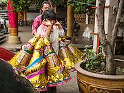 "06 AUGUST 2014 - BANGKOK, THAILAND:  People bring ""Hell Money""  and ""Joss Paper"" to be burned at Wat Mangkon Kamalawat, a large Chinese Mahayana Buddhist temple in Bangkok. Burning ""hell money"" is common during Hungry Ghost month.   PHOTO BY JACK KURTZ"