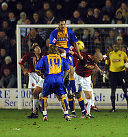 Photo: Dave Linney.<br />Walsall v Shrewsbury Town. Coca Cola League 2. 26/12/2006. Walsall's Michael Dobson (R) and Shrewsbury's  Stuart Drummond batle in front of goal at Bescot this afternoon.