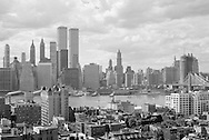 The World Trade Center, Lower Manhattan, Brooklyn Heights, the Brooklyn Bridge and the East River waterfront in July or August, 1974. The image comes from a high-quality 35mm black and white negative and prints well at sizes up to at least 12 x 18 inches. WATERMARKS WILL NOT APPEAR ON PRINTS OR LICENSED IMAGES.
