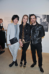 Left to right, SHARLEEN SPITERI, NOOMI RAPACE and KINDER AGGUGINI at a private view of work by the late Rory McEwen - The Colours of Reality, held at the Shirley Sherwood Gallery, Kew Gardens, London on 20th May 2013.