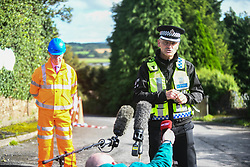 © Licensed to London News Pictures. 08/08/2020. City, UK. Superintendent, Andy Morgan from British Transport Police  leads a evening press conference at the scene of the freight train accident in Llangennech, near Llanelli in Wales. The train was carrying a vast amount of diesel fuel which caused a huge fire and spilled into nearby waterways. The fire is still ablaze and the fire service continue to contain it into the evening. Photo credit: Robert Melen/LNP