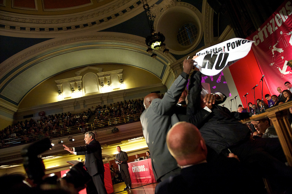 A heckler disrupts Prime Minister Gordon Brown's speech at the Citizens UK conference at Central Methodist Hall in Westminster, London, at which Conservatives leader David Cameron and Liberal Democrats leader Nick Clegg also spoke.  With the general election looming on 6 May 2010, considered to be the closest and most fiercely fought in decades, candidates are campaigning at a torrid pace, holding many events throughout the UK.