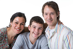 Young boy with his parents; smiling,