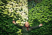 Woman dressed in Green posing in front of green flowers during Floralies flowerfestival, ghent, belgium, 27.04.2016