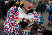 On the day that Prime Minister Theresa Mays Meaningful Brexit vote is taken in the UK Parliament, a protesting Remainer uses her phone opposite the House of Commons, on 15th January 2019, in Westminster, London, England.