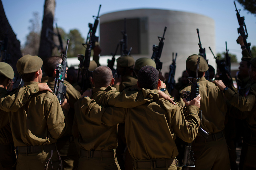 Israeli Jewish Orthodox and ultra-Orthodox soldiers of the Israeli military Netzah Yehuda Battalion ?(also known as Nahal Haredi brigade) celebrate after completing their swearing-in ceremony held at the Ammunition Hill national memorial site in Jerusalem, Israel, on May 31, 2012. The unit, part of the Israeli Defense Forces Kfir Brigade, was created by a group of rabbis in cooperation with the IDF and Israel's Ministry of Defense, as a venue for young men who wish to serve the national interests of the state of Israel while adhering to the highest religious standards.