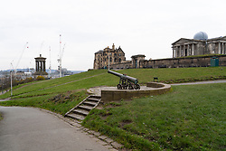 Edinburgh, Scotland, UK. 24 March, 2020.  Calton Hill lies deserted. The famous landmark is normally busy with tourists at this time of the day. All shops and restaurants are closed with very few people venturing outside following the Government imposed lockdown today.  Iain Masterton/Alamy Live News