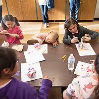 Kids decorate piggy banks at the piggy bank pageant held at the Octavia Fellin Public Library Children's branch, Wednesday, Jan. 30. Photos of the piggy banks will be posted on social media and the winner gets a saving account opened in their name.