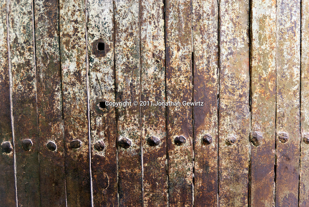 Antique wrought-iron door with rivets, Jerusalem. WATERMARKS WILL NOT APPEAR ON PRINTS OR LICENSED IMAGES.