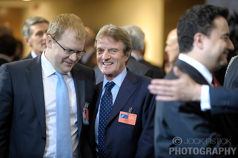 Bernard Kouchner, France's foreign minister, center, shares a laugh with Urmas Paet, Estonia's foreign minister, during a foreign ministers meeting at NATO headquarters in Brussels, Thursday, March 5, 2009. Photo © Jock Fistick)