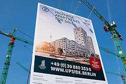 New luxury high-rise  apartment building (Upside) under construction beside East Side Gallery in Friedrichshain, Berlin, Germany. Property development in Berlin is booming at present due to rising cost of real estate and land.