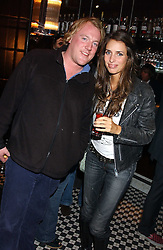 MARINA HANBURY and ROB HUNTINGTON at a party to launch the Frankie's TLC Card and the TLC Clubcard held at Frankie's Knightsbridge, 3 Yeomans Row, London SW3 on 1st February 2006.<br /><br />NON EXCLUSIVE - WORLD RIGHTS