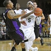 Central Florida guard Marcus Jordan (5) drives the ball against Furman guard Darryl Evans (5) during an NCAA basketball game at the UCF Holiday Classic at the UCF Arena on December 29, 2010 in Orlando, Florida. (AP Photo/Alex Menendez)