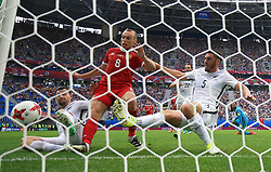 New Zealand's Michael Boxall (right) scores an own goal, giving Russia their first goal of the game