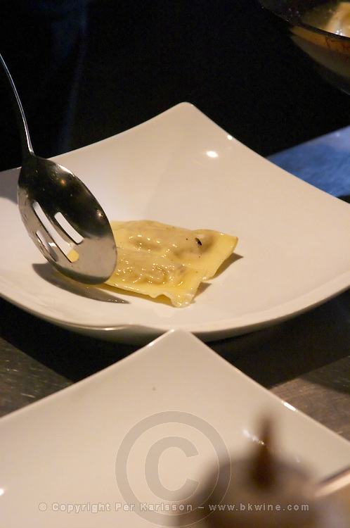 a Ravioli placed with a spoon on a white plate with truffles The O'Farrell Restaurant, Acassuso, Buenos Aires Argentina, South America
