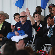 Referee Mills Lane acknowledges the crowd after being inducted into the Hall of Fame during the 2013 International Boxing Hall of Fame induction ceremony on Sunday, June 9, 2013 in Canastota, New York.  (AP Photo/Alex Menendez)