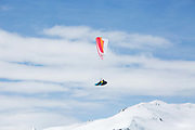A male paraponter flying above Laax Ski Resort on the 5th April 2019 in Laax in Switzerland.