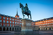 """The Plaza Mayor is a major public space in the heart of Madrid, the capital of Spain. It was once the centre of Old Madrid. It was first built (1580–1619) during the Habsburg period of Philip III's reign. Only a few Spanish blocks away is another famous plaza, the Puerta del Sol. The Plaza Mayor is for the people of Madrid and tourists to shop, walk around, eat, and enjoy the outdoors. The Plaza Mayor dates back to the 15th century where it was originally called the """"Plaza del Arrabal"""" and was used as the main market of the town. In 1561, the plaza was transferred to the city of Madrid. King Philip II commissioned Classical architect Juan de Herrera to remodel the area. Construction did not begin until Philip III's reign in 1617. Juan Gómez de Mora continued on the architectural renovation, and was finished two years later in 1619. The Plaza Mayor has suffered 3 major fires in its history. The first was in 1631. Juan Gómez de Mora took on the reconstructions of the plaza following this fire. The second of the fires occurred in 1670, with the architect Tomás Román in charge of the reconstruction. The last fire consumed a third of the square and took place in 1790. Today, the Plaza Mayor's architecture is credited to Juan de Villanueva. He handled the reconstruction following the massive fire in 1790. Prior to this, the buildings that enclosed the square were five stories. Juan de Villanueva lowered the square's surrounding buildings to three stories, closed the corners and created large entrances into the squares. Construction after Juan de Villanueva's death by Antonio López Aguado and Custodio Moreno and was finished in 1854."""