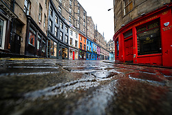 Edinburgh, Scotland, UK. 20 January 2020. Views of quiet streets in Edinburgh city centre on day after First minister Nicola Sturgeon announced national lockdown would be extended into February. Streets remain very quiet with no non essential shops open. Pic; Victoria Street in the Old Town is deserted.  Iain Masterton/Alamy Live News