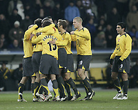 Photo: Barry Bland.<br />FC Thun v Arsenal. UEFA Champions League. 22/11/2005.<br />Arsenal celebrate after Robert Pires scores.