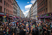 """01/05/2015 – Berlin, Germany: Overcrowded Adalbertstraße in during the """"Myfest"""" street festival. """"Myfest"""" takes place in district SO 36, the traditional centre of riots that usually occur during May Day celebrations and it was organized to decreased the violence caused by Revolutionary May Day Demonstrations.  The radical left wing criticises such events claiming that it is pretended to pacify social conflicts and to ban radical demonstrations. The International Workers Day is a celebration of laborers and the working classes that is promoted by the international labor movement, anarchists, socialists, and communists and occurs every year on May Day. (Eduardo Leal)"""