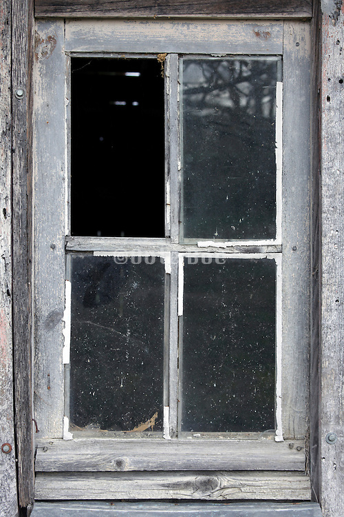 window in a abandoned shed