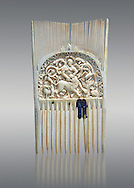 Medieval ivory comb with a central relief panel depicting David defeating a Lion. Third quarter of the 9th cent. AD from Metz. Inv. OA 354, The Louvre Museum, Paris. .<br /> <br /> If you prefer you can also buy from our ALAMY PHOTO LIBRARY  Collection visit : https://www.alamy.com/portfolio/paul-williams-funkystock/romanesque-art-antiquities.html . Type-     Fasillar      - into the LOWER SEARCH WITHIN GALLERY box. Refine search by adding background colour, place, museum etc<br /> <br />  Visit our MEDIEVAL PHOTO COLLECTIONS for more   photos  to download or buy as prints https://funkystock.photoshelter.com/gallery-collection/Medieval-Romanesque-Art-Antiquities-Historic-Sites-Pictures-Images-of/C0000uYGQT94tY_Y