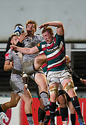 Leicester Tigers flanker Tommy Reffell competes for a high ball with Sale Sharks fly-half AJ McGinty during a Gallagher Premiership Round 7 Rugby Union match, Friday, Jan. 29, 2021, in Leicester, United Kingdom. (Steve Flynn/Image of Sport)