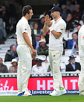 Cricket - 2017 South Africa Tour of England - Third Test, Day Two<br /> <br /> England debutant, Toby Roland - Jones celebrates his third wicket during the afternoon session as he talks it over with Jimmy Anderson at The Oval.<br /> <br /> COLORSPORT/ANDREW COWIE