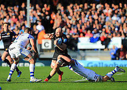 Exeter Chiefs' Matt Kvesic is tackled by Bath's Sam Underhill and Elliott Stooke during the Gallagher Premiership match at Sandy Park, Exeter.