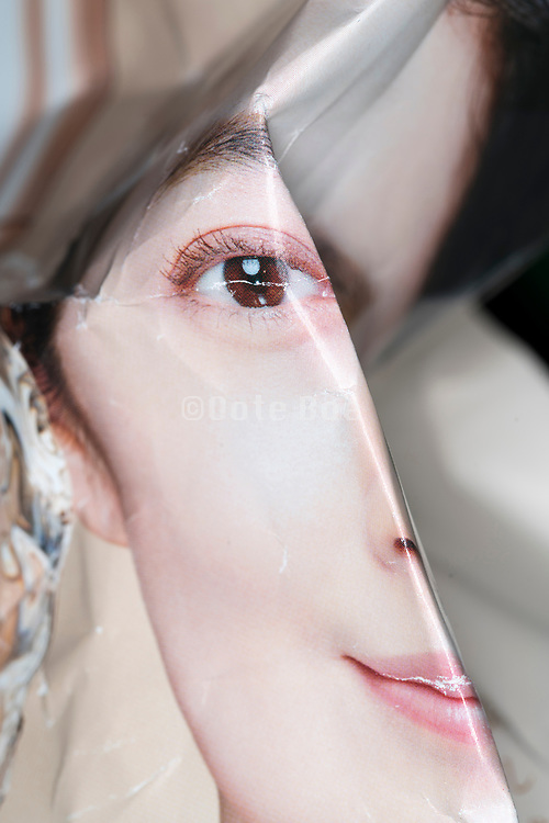 crumpled magazin print woman portrait